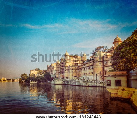 Vintage retro hipster style travel image of romantic India luxury tourism concept background - Udaipur City Palace and Lake Pichola. Udaipur, Rajasthan, India with grunge texture overlaid - stock photo