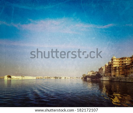 Vintage retro hipster style travel image of romantic India luxury tourism concept background - Udaipur City Palace, Lake Palace and Lake Pichola with grunge texture overlaid. Udaipur, Rajasthan, India - stock photo