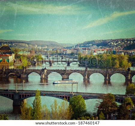 Vintage retro hipster style travel image of travel Prague concept background - elevated view of bridges over Vltava river from Letna Park. Prague, Czech Republic with grunge texture overlaid - stock photo