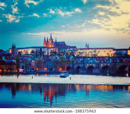 Vintage retro hipster style travel image of travel Prague Europe concept background - view of Charles Bridge and Prague Castle in twilight. Prague, Czech Republic - stock photo