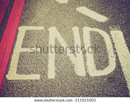 Vintage retro looking Sign of end of bicycle lane - stock photo