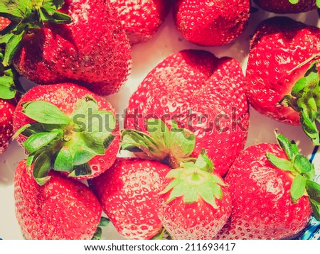 Vintage retro looking Strawberry fruit - useful as a background - stock photo