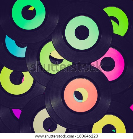 Vintage retro looking Vinyl record vintage analog music recording medium - stock photo