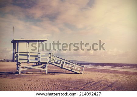 Vintage retro picture of wooden lifeguard tower, Beach in California, USA. - stock photo