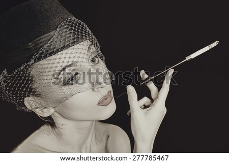 vintage Retro portrait of beautiful young caucasian woman in veil with cigarette closeup  - stock photo