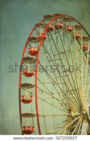 Vintage retro red ferris wheel.  Cross processed to look like and instant picture with texture. instagram style - stock photo