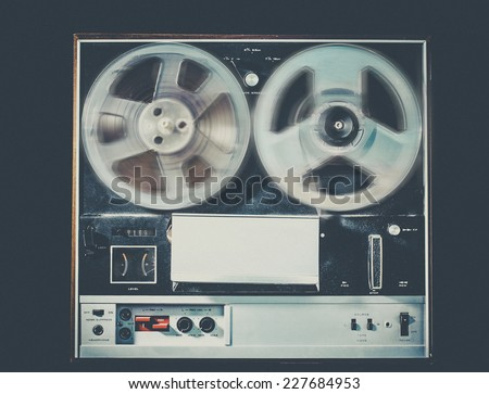 Vintage retro style photo with grain of reel to reel tape deck,  - stock photo