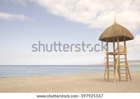 Vintage retro tone, Sunchair Lifeguard tower on caribbean beach, Haiti                                   - stock photo