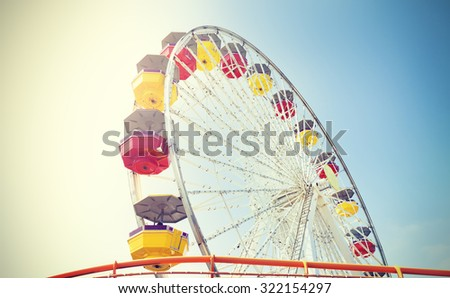 Vintage retro toned picture of an amusement park. - stock photo