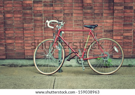 Vintage road bicycle parked on the street in Toronto - stock photo