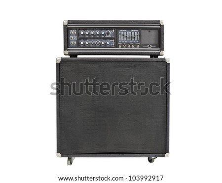 Vintage rock and roll bass amplifier isolated on white. - stock photo