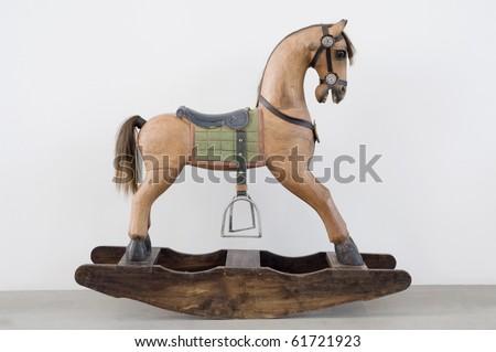 vintage rocking horse isolated on white background - stock photo