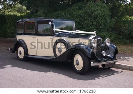 Vintage Rolls Royce wedding car - stock photo