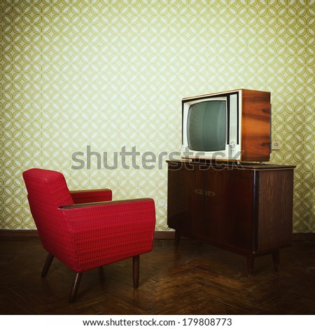 Vintage room with two old fashioned armchair and retro tv over obsolete wallpaper. Toned - stock photo