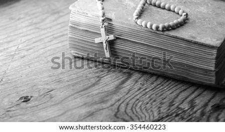 vintage rosary beads on old books,horizontal photo - stock photo