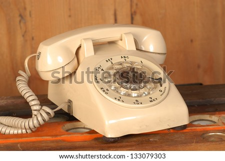 Vintage rotary phone - stock photo