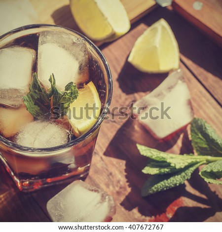 Vintage.  RUM , coctail cuba libra, rum and cola cuba libre with lime and Ice into the glass beaker closeup - stock photo