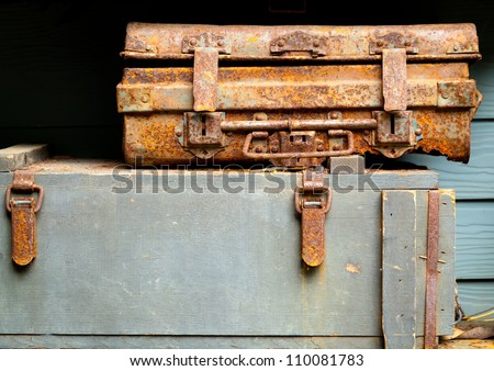 vintage rusty metal box and old ruin wooden box display - stock photo
