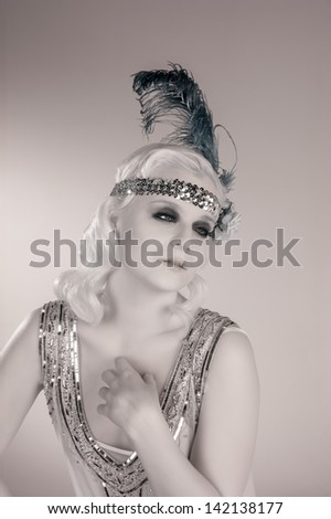 Vintage 1920's flapper girl in black and white. - stock photo
