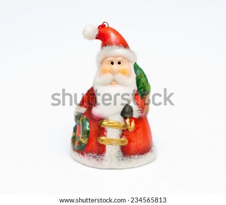 vintage Santa Claus figure christmas decoration on white background - stock photo