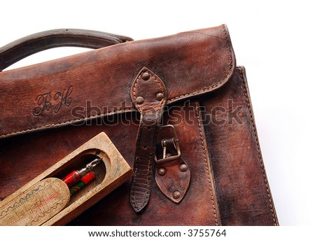 Vintage schoolbag - detail, isolated - stock photo