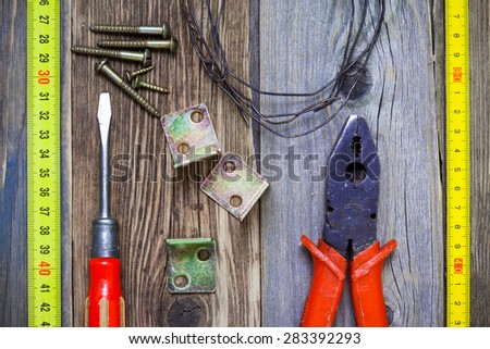 Vintage screwdriver, old pliers, screws, wire, angles and roulette. Still life with old tools - stock photo