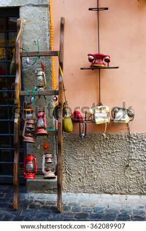 Vintage set of landline phones and lanterns near Gandolfo castle in Rome, Italy - stock photo