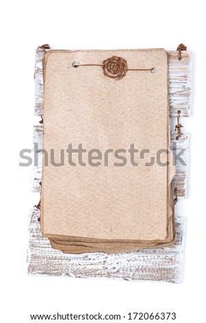 Vintage sheets of paper for the recipe on a wooden base, isolated on white - stock photo
