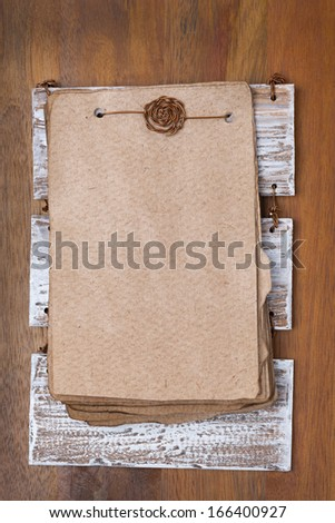 Vintage sheets of paper for the recipe on a wooden base, top view, vertical - stock photo