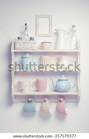 Vintage shelf in the kitchen, shabby chic style, retro toned - stock photo