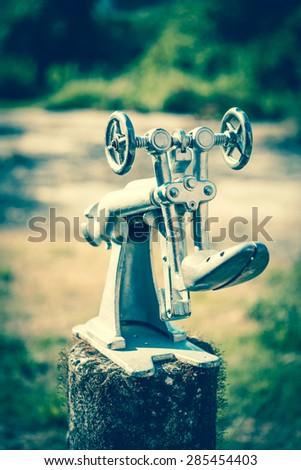 Vintage shoemaker tools - stock photo