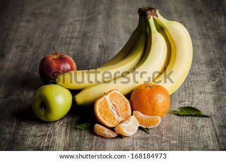 Vintage shot of fruits on wooden background - stock photo