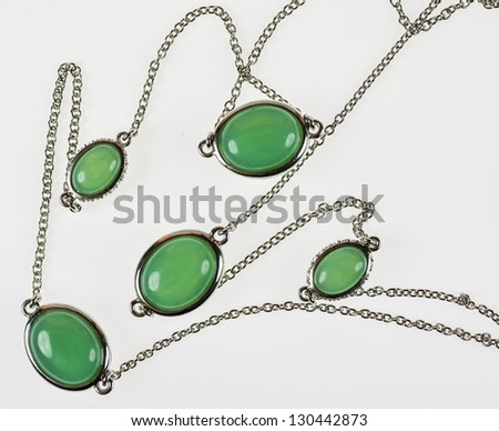 Vintage silver necklace with jade - closeup isolated on white background - stock photo