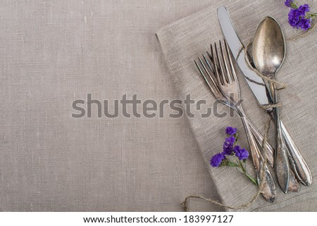 Vintage silverware with flowers - stock photo
