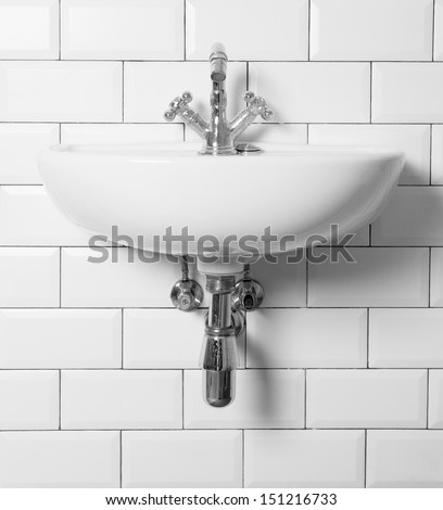 vintage sink and tap - stock photo