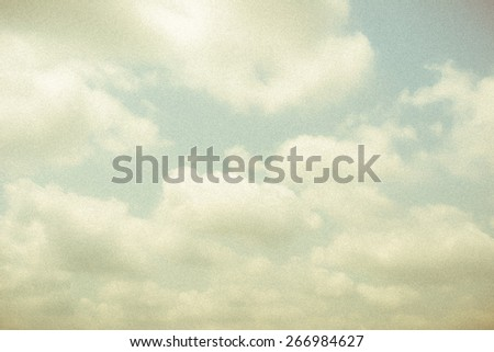 Vintage sky and soft clouds with grainy texture and vignette for backgrounds  - stock photo