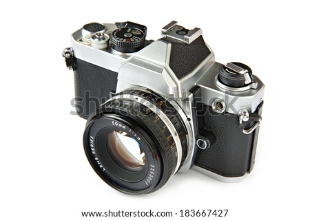 Vintage SLR camera isolated - stock photo