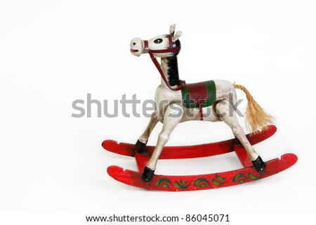 Vintage small rocking horse with red rockers on a white background - stock photo