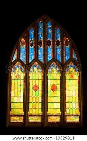 Vintage stain glass church window - stock photo