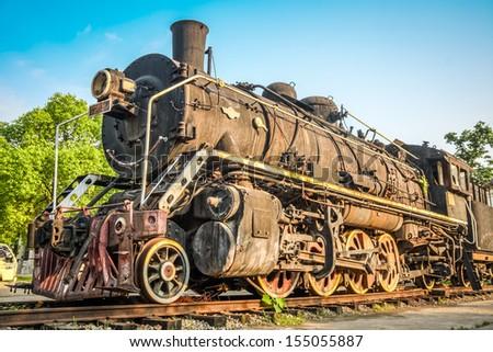 vintage steam train under sunny sky - stock photo