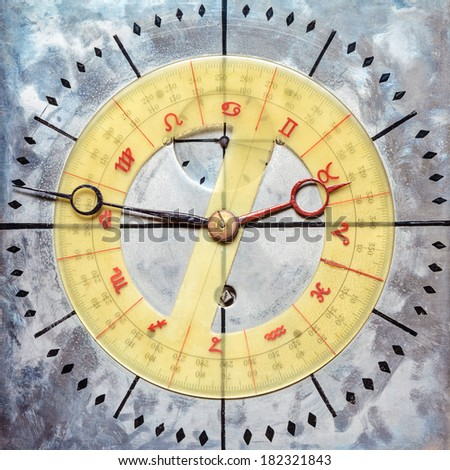 Vintage steel clock face with astrology and astronomy dial - stock photo