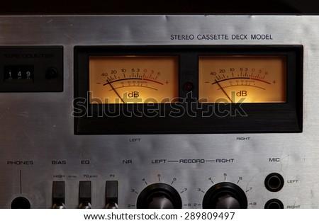 Vintage stereo cassette tape deck player recorder VU meters closeup - stock photo