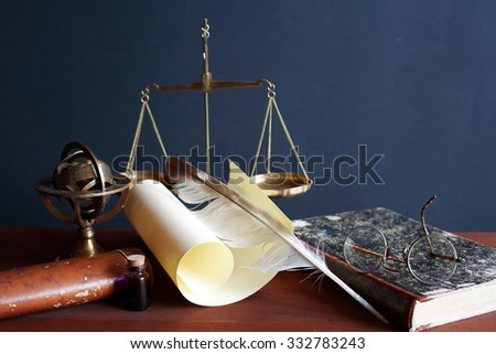 Vintage still life. Old weight scale near scroll and other vintage things - stock photo