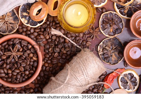 Vintage still life with coffee beans on wooden background - stock photo