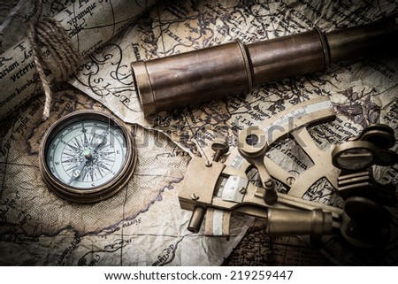 vintage  still life with compass ,sextant ,spyglass ,and old map - stock photo