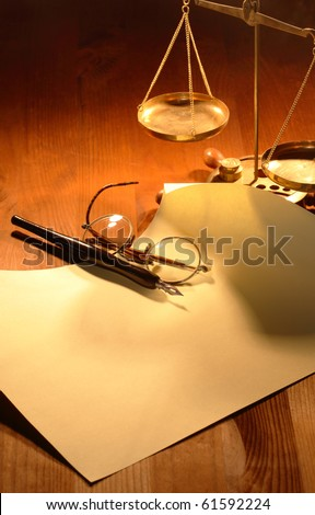 Vintage still life with old brass balance,ink pen and paper on wooden background - stock photo