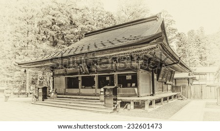 Vintage style black and white image of one of the buildings in the Okunoin Cemetery in Koyasan, Japan. Okunoin is one of the most sacred places in Japan and a popular pilgrimage spot. - stock photo