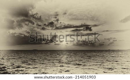 Vintage style black and white image of the sunset at the beautiful tropical paradise island, the Maldives - stock photo