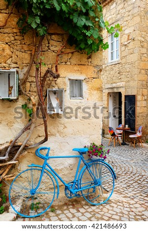 Vintage Style Blue Painted Bicycle in Alacati Streets - stock photo