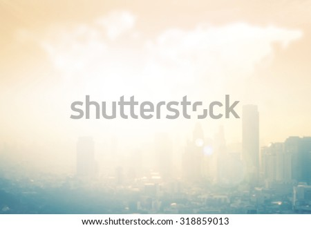 Vintage style. Blurred beautiful golden warm sunrise city with circle light over world map of clouds background. Blur background concept. - stock photo